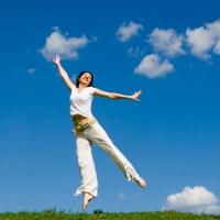 jumping girl in meadow